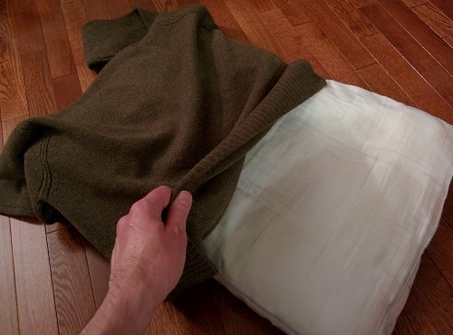 Covering a pillow with a sweater